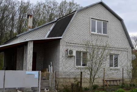 полутораэтажный дом из кирпича